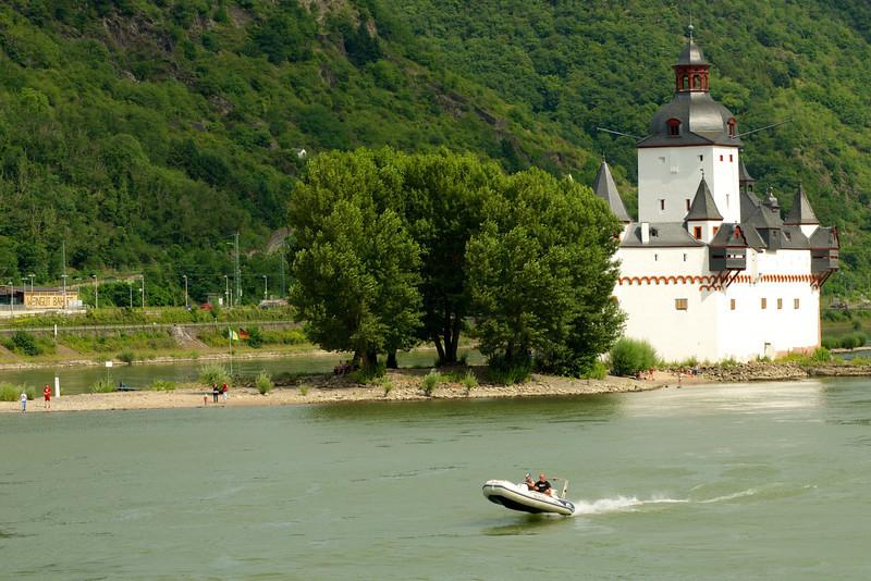 """""""Sailing"""" inflatable next to Pfalzgrafenstein Castle near Kaub, Germany."""