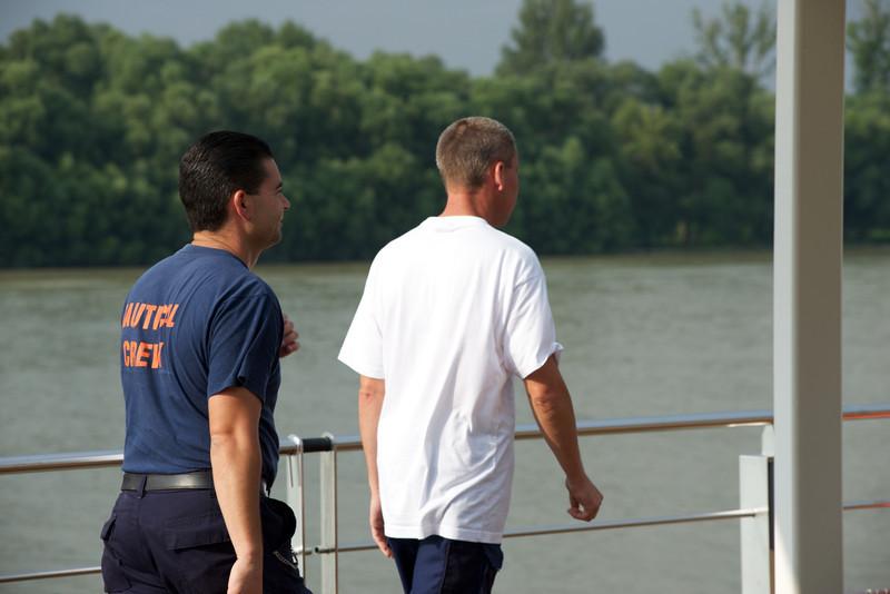 Nautical crew members prepare to dock in Bratislava.