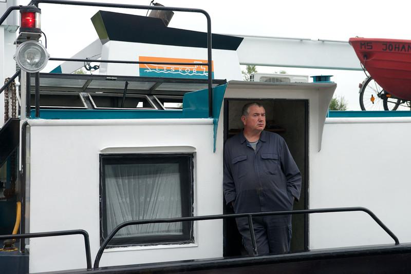 Sailing close to this pleasant boat captain.