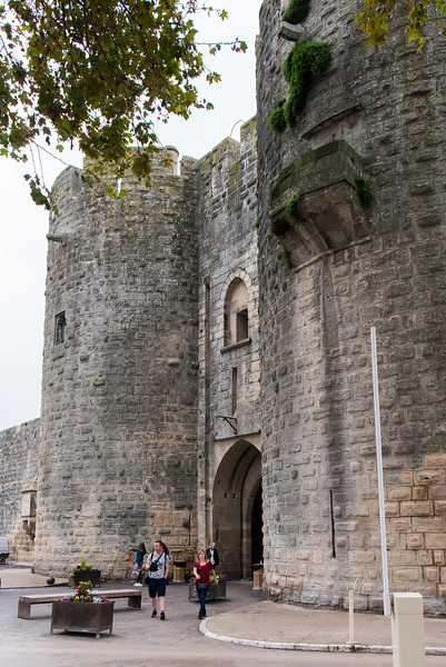 The well-preserved medieval city wall of Augies-Mortes. Aigues-Mortes is connected to the Mediterreanean sea through the Canal du Rhône à Sète.