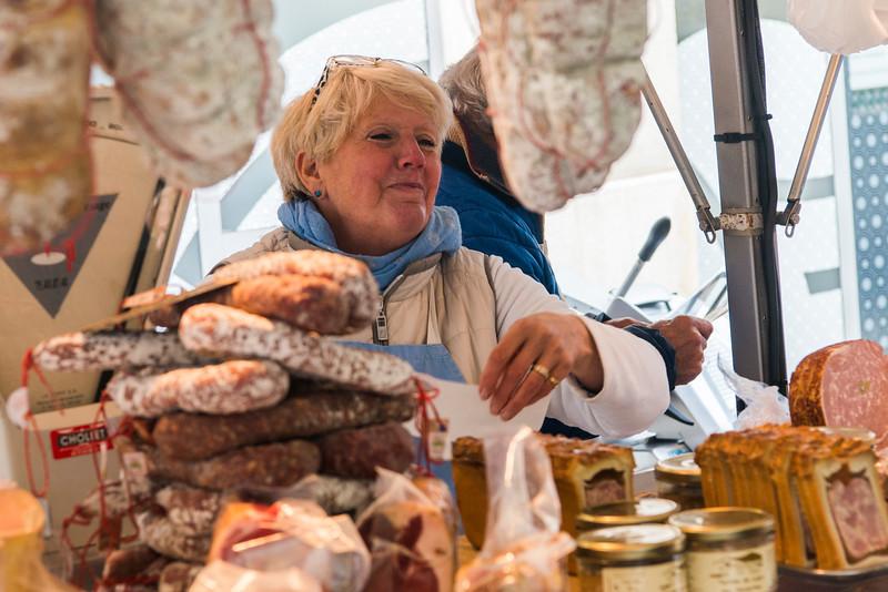 Vienne street marche (market) seller.  Fournisseur saucisse.