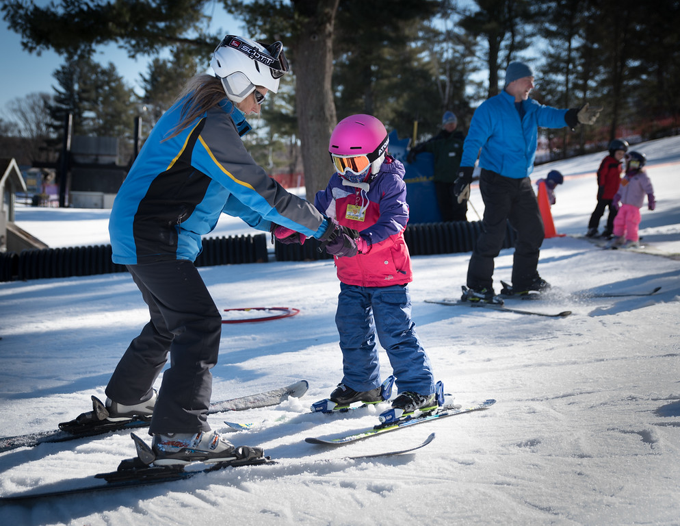 . Nashoba Valley Ski Area instructor, Mary-Anne Noddin-Poulin of Cape Cod, teaches 5 year old, Indira, how to stay upright and snowplow during classes Monday afternoon.  Photo:  Scot Langdon / SUN
