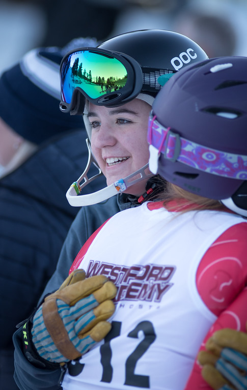 . Westford Academy\'s ski team Captain and Senior, Hannah Browne, (L) hugs team pal, Lindsay Harris, after the Varsity skiers finish up.    Photo:  Scot Langdon / SUN