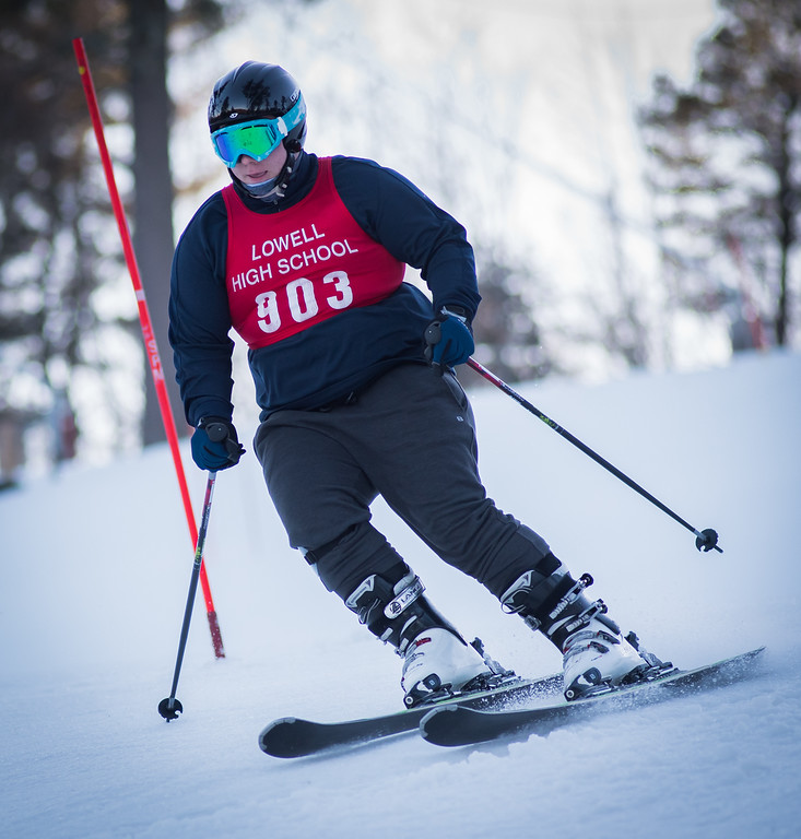 . Lane Longtin, Varsity skier from Lowell High School, raced Monday in an area competition at the Nashoba Valley Ski Area.  Photo: Scot Langdon / SUN