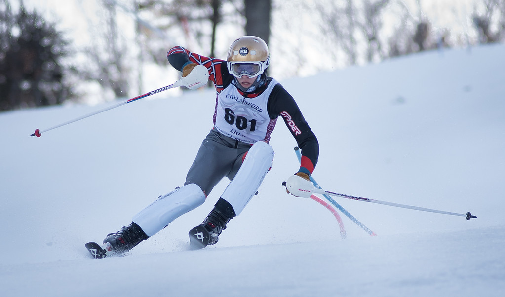 . Varsity skier, Ryan Hart of Chelmsford, works the slalom course during Monday\'s area competition at Nashoba Valley Ski Area.   Photo:  Scot Langdon / SUN