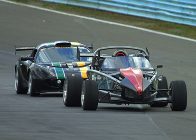 "Ariel Atom 2 in the lead over a Lotus Exige Cup Car, coming up through the ""Esses"" at Watkins Glen International"