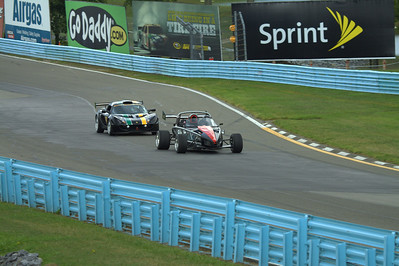 Ariel Atom 2, in the lead over a Lotus Exige Cup Car at Watkins Glen International
