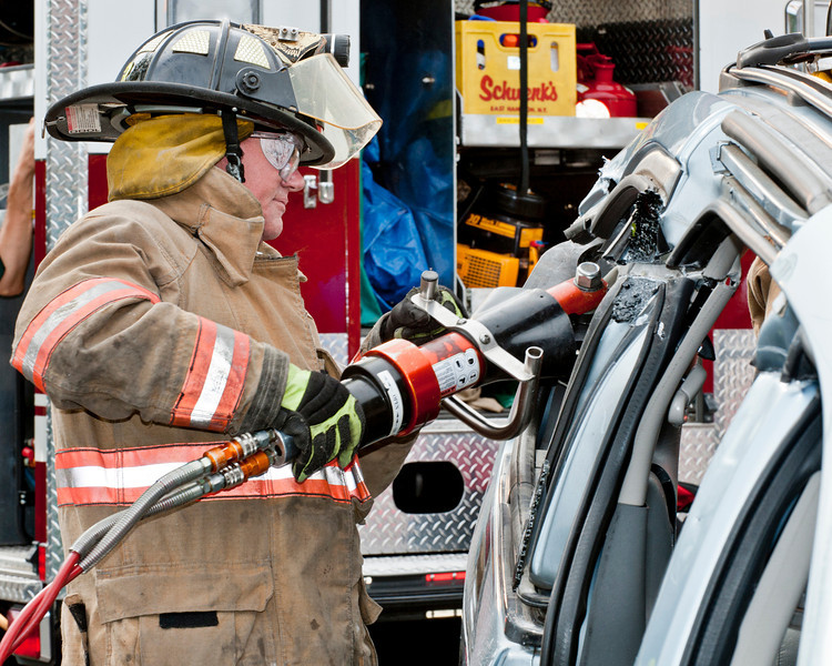 "Fireman Ed Loder demonstrates the ""jaws of life."""