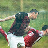 A well timed header from Portree's Robbie Weir amidst the shocking conditions during the Ross Cup final.