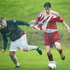 Ryan O'Halloran receives a helping hand from Portree's Stevie Morrison.