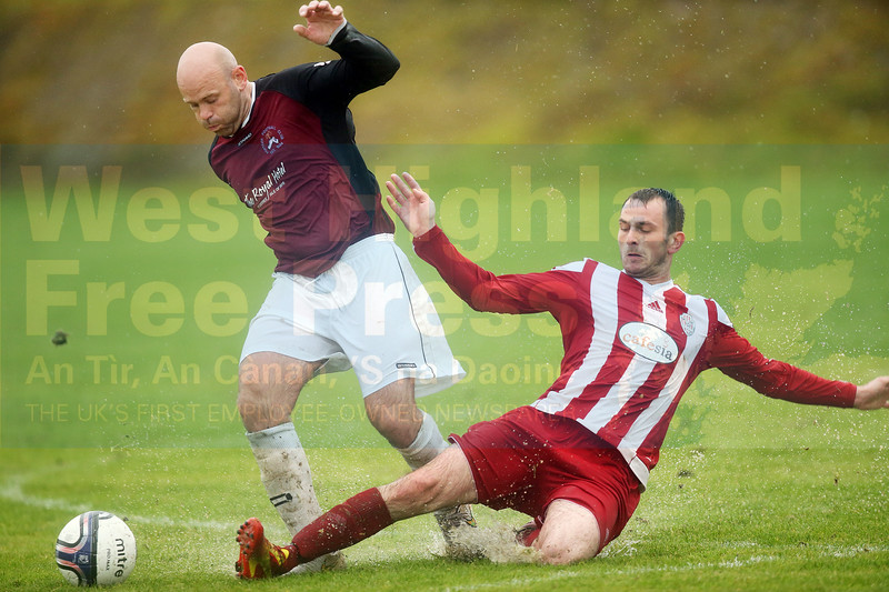 Man of the match Gordy McCarroll with a sliding tackle on Mark MacLeod.