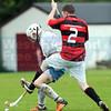 An unusual tackle on Chris MacLennan by Glen's James MacPherson.