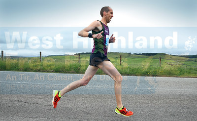 Local runner Jeremy Rossiter eases along through the Skeabost area on his way to third place.