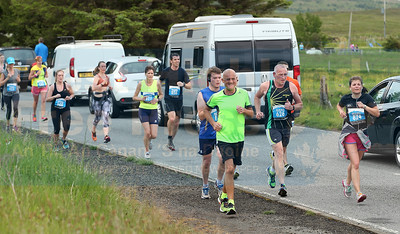 Runners setting a steady pace through Carbost.
