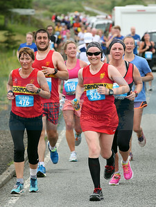 Stornoway ladies Adrienne Stewart and Carolyn Hare lead a pack of runners through Carbost.
