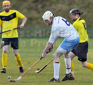 William MacKinnon gets in ahead pf Padraig McNeil