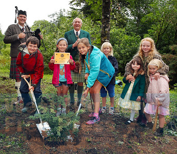 Local children including,  Beinn John MacRae and Mairi Stephen, were on hand to help Lord Godrey Macdonald plant a slow-growing Alerce tree, in the magnificent gardens of Armadale Castle.