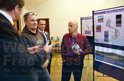 Uig resident James MacDonald listens to Colin Howell Director of Roads and Transport at HC, as Andrew MacIver and Cllr John Finlayson look on.