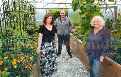 Norma Morrison , Nicholas Kelly and Shirley Grant are pictured inside one of the productive polytunnels.