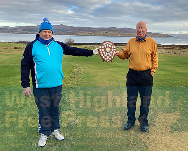Our eminent golf correspondent, John Marshall, was amongst the prize winners and is pictured receiving his trophy from the club's new captain, Ally Young.