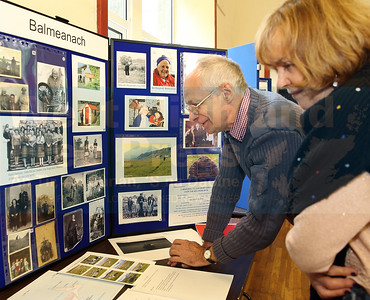 Catherine Atkins and John Nichols study some of the old photographs from the Balmeanach area.