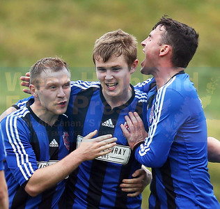 Sleat players celebrate with Josh Knowles on scoring the winning goal.