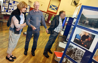 Catherine Atkins, one of the event organiser's, shows local resident John Nichols around the exhibition.