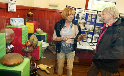 Catherine Atkins shows Janet Lodge, a new resident to the area, some of the artefacts at the exhibition.