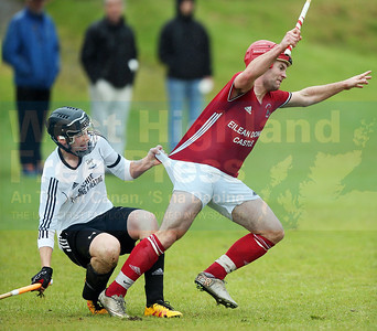Your going nowhere - Keith MacRae has his progress hampered by Lovat defender Calum Cruden.