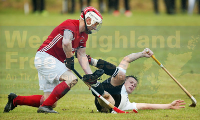 Fraser MacVicar recovers quickly as Martin Mainland goes to ground.