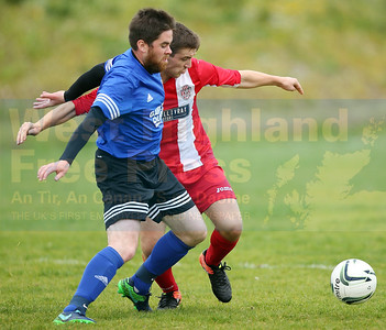 A midfield tussle between Sleat's Ben Yoxon and ----
