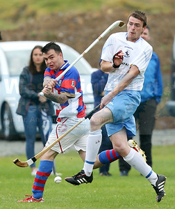 Kingussie defender Ryan Borthwick clears from the on-rushing Danny Morrison.
