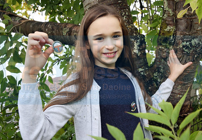 lLexy MacLeod (11) from Clann Throndairnis with her gold medal for story-telling fluent 11-12.
