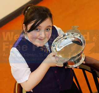 Mary Sophia Morrison from Laxdale with the Angus Nicol Memorial Trophy for poem 11-12.