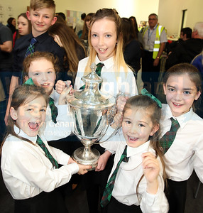 Members of Rionnagan Rois are clearly delighted with their Mod Silverware.