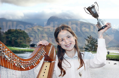 Having conquered Ben Nevis to pass the time on Tuesday, Anna Pearson (11) from Bun-sgoil Taobh Pairce went on to win the Florence Wilson Trophy for elementary clarsach on the Wednesday morning, from 24 fellow competitors.