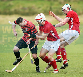 Oban's Malcolm Clark is pinned down by Finlay MacRae and Connor Cormack.