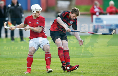 John MacRae lies in wait of any slip up by the Oban defender.