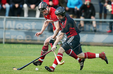 Connor Cormack and Daniel Cameron show their determination to win the ball.
