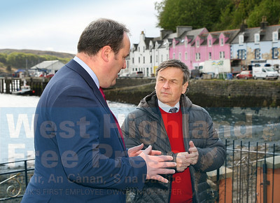 Paul Wheelhouse chats with Alastair Danter from Skye Connect during a visit to Portree harbour last Friday.