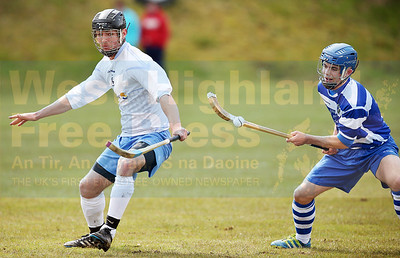 Good stick-work from Ian Robinson as Ali Cleodi MacLeod awaits any slip up.
