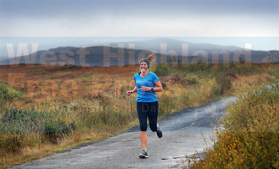 The autumn colours lift a misty Saturday afternoon as Vicky Dunkel sets a steady pace durING the Skeabost 5K.