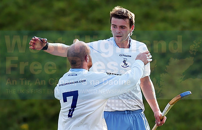 Danny Morrison celebrates the winning goal with Skye's other scorer, Kenny Campbell.