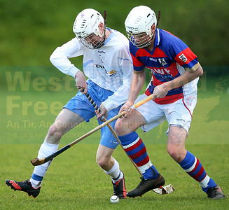 James Pringle and Roddy Young in a tussle for the ball.