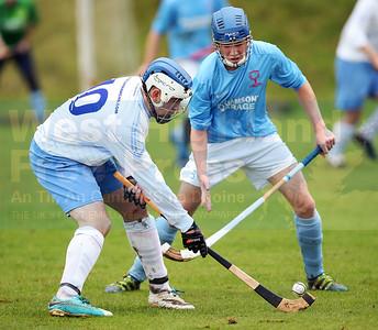 Skye forward Iain MacLellan looks to get past Ben MacDonald.