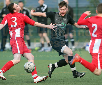 Paul MacKinnon who scored a wonderful goal for the Juniors, poses problems for the Sleat defence.