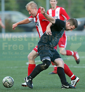 Sleat's Gordon MacKenzie and Juniors veteran John Murphy get in a tangle.