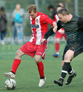 Connor Yoxon attempts to hold off Juniors defender Iain Munro.