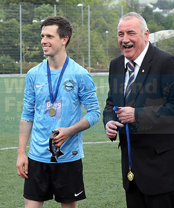 NW Skye's Iain Beaton after receiving his MOM award from WHAFA Chairman Steve McNeill.