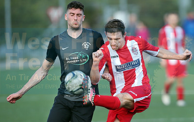 A midfield clash between Dean MacLeod and Ben Yoxon.